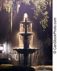 Fountain back-lit by streetlight