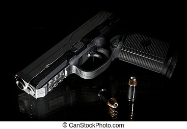 night handgun - handgun on a glass bedstand in the middle of...