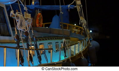 Night Harbor Ship View - SIde view of a wooden sip in the...