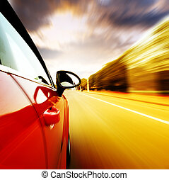 Night, high-speed car - A car driving on a motorway at high...