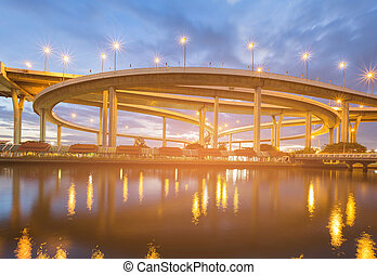 Night highway intersection river front