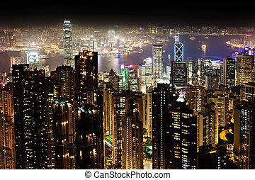 HONG KONG - FEBRUARY 22: Cityscape of Hong Kong island from Victoria peak on February, 22, 2013. The Victoria Harbour is world-famous for its stunning panoramic night view and skyline.