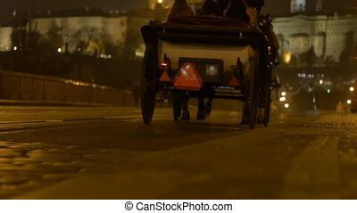 Night Horse Chaise in Prague - A night carriage passing over...