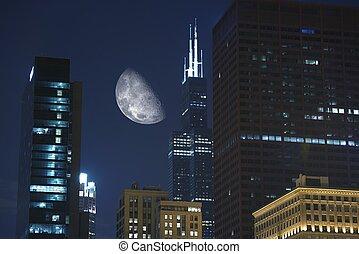 Night Hours in Chicago. Large Moon Between Skyscrapers. ...