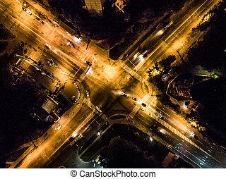 night illuminated city crossroad