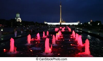 illuminated fountains on Poklonnaya Hill, obelisk and church...