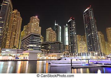Night illumination at Dubai Marina. It is an artificial...