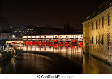 Night illumination of Barrage Vauban (Vauban weir) on the Ill river, Strasbourg - Alsace, France