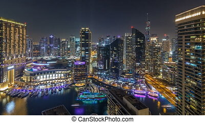 Night illumination of Dubai Marina aerial timelapse, UAE....