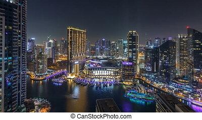 Night illumination of Dubai Marina aerial timelapse, UAE....