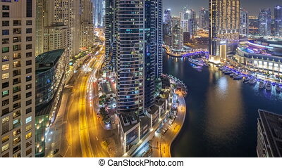 Night illumination of Dubai Marina aerial timelapse, UAE. -...