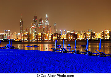 Night illumination of the luxury hotel beach on Palm Jumeirah man-made island, Dubai, UAE