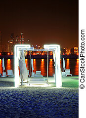 Night illumination of the luxury hotel on Palm Jumeirah man-made island, Dubai, UAE