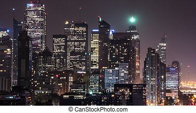 Night in Toronto. Long exposure of urban lighted skyline on...