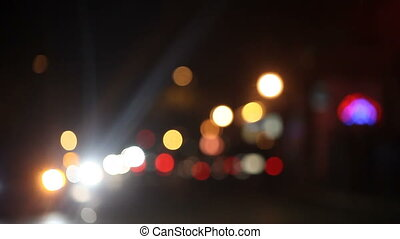 night intersection with pedestrians - defocused intersection...
