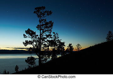 Night landscape against a decline lake Baikal