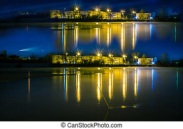 night landscape of a city reflection in the water