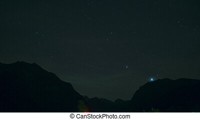 Night landscape with mountains and stars. Time lapse