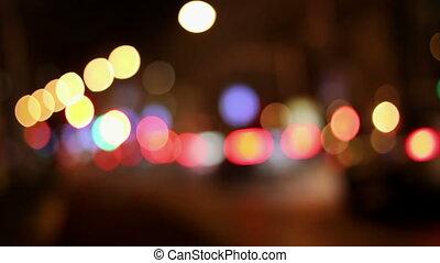 Night lights city blurred traffic. Defocused background.