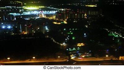 Night lights of city from plane window