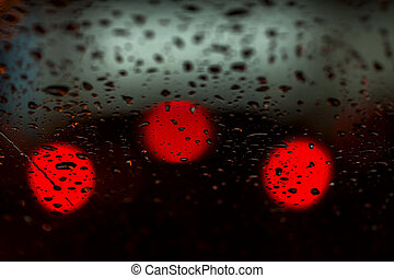 Night lights of urban traffic seen through the windshield in...