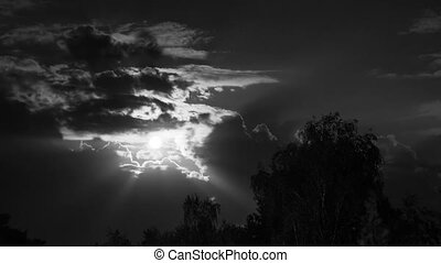 Night Moon Rising on the Horizon over the Trees and Clouds. Time Lapse