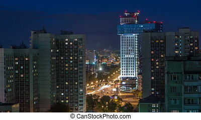 Night Moscow cityscape from rooftop timelapse. Residential buildings at night. Night view from the roof
