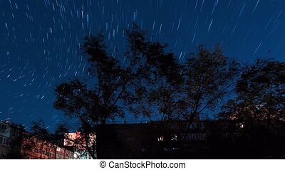 Night motion of stellar lines over houses Yerevan, Armenia...