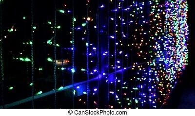 Night multicolored illumination on the office building,...