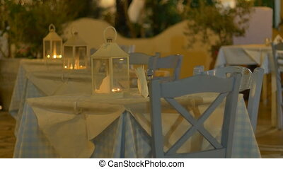 Night Outdoor Greek Restaurant - Blue and white tablecloth...