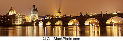 Night panorama of Charles bridge in Prague, Czech Republic.