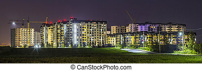 Night panorama of new built and still under construction apartment buildings