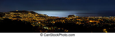 Night panoramic view of Nice with moon light on the sea water