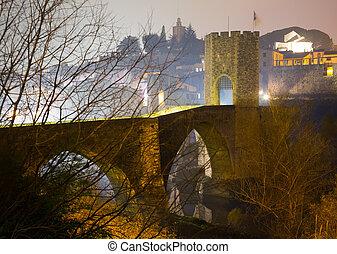 night photo of medieval bridge. Besalu, Spain