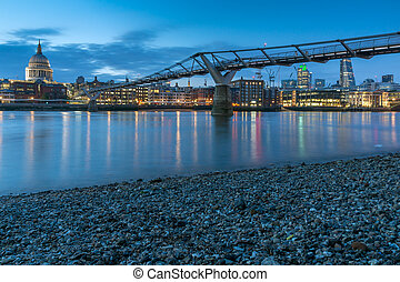 Night photo of Millennium Bridge and  St. Paul Cathedral, London
