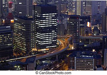 night photo of modern cityscape, central Osaka, japan
