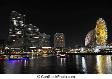 Yokohama - Night photo of Yokohama downtown reflcting in the...