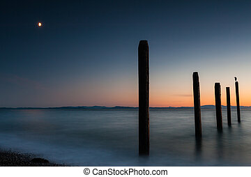 Point Roberts pilings and silky water at night time
