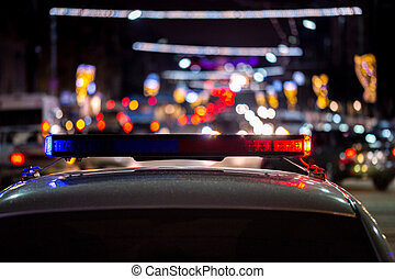 night police car lights in city - close-up with selective focus and bokeh