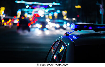 night police car lights in city - moody close-up with selective focus and bokeh