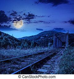 night rail metal bridge in mountains - mountains landscape....