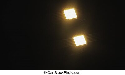 Night rain on the road lantern. Warm tone. Closeup shot