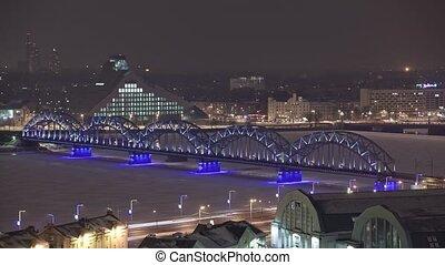 Night Riga city winter timelapse, lights, bridge, Daugava...