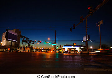 Night road and traffic lights in Las Vegas, USA