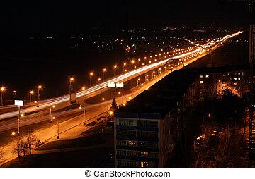 night road through bridge with street lamps