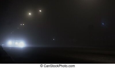 night roadway or highway with bad or poor visibility due to...