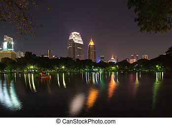 Night scene of Bangkok skyline at dusk from Lumphini Park