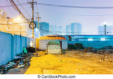 Night scene of messy residential area