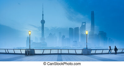 Night scenery view of Shanghai skyline at mist