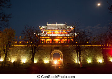 Night scenic of city gate and city wall in ancient city of Dali